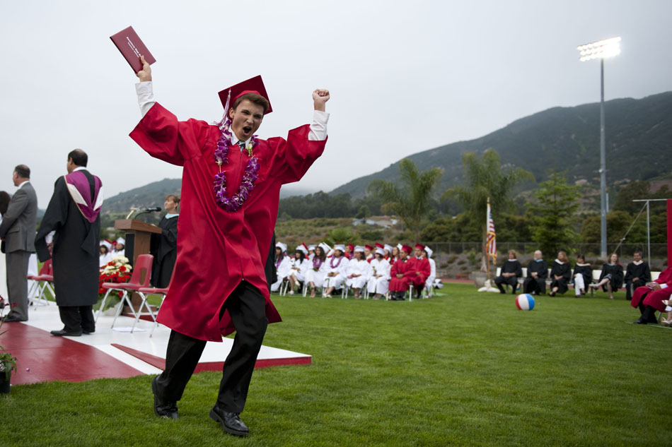Diploma in hand, Carpinteria High School graduate Christian Plude celebrates after crossing the stage at the commencement ceremony held at Carpinteria Valley Memorial Stadium at Carpinteria High School on Friday, June 10, 2011. Plude was one of 152 Carpinteria High School graduates.