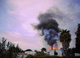 A mobile home burns at sunset on Ventura Ave in Ventura Calif., on Tuesday, Oct. 4, 2011.
