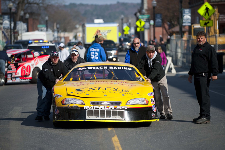 Kyle Welch and the Welch racing team push their car up Main Street in Barre, Vermont at the start of the Thunder Road Car Show on Main Street in Barre, Vermont on Saturday, April 27, 2013.