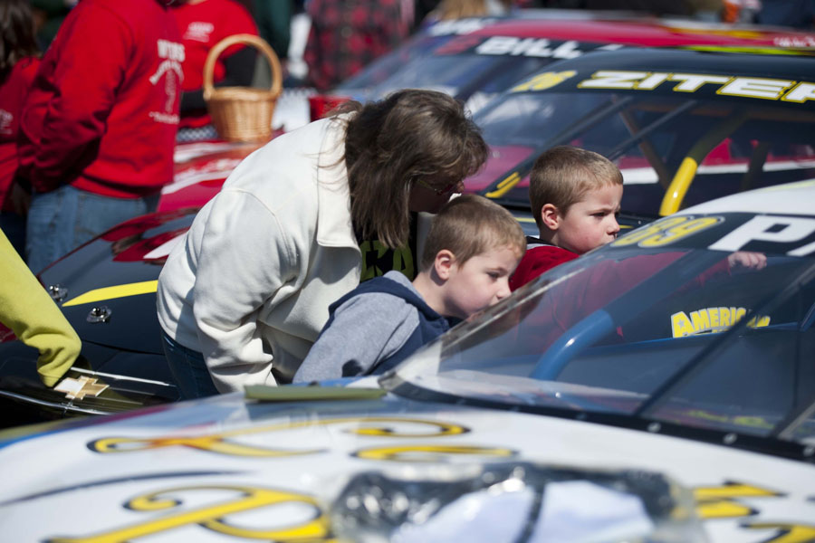 Donna Gagnon, center, and her twin grandsons Connor Murray and Chase Murrah, 5, inspect a race car at the Thunder Road Car Show on Main Street in Barre, Vermont on Saturday, April 27, 2013.