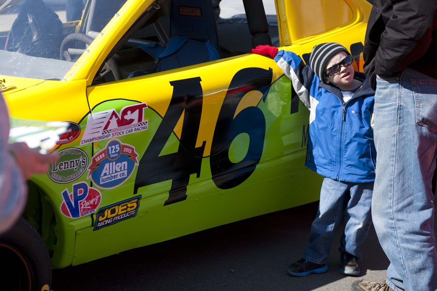 Benjamin Hebert, 4, checks out the Froogy 100.9 #46 race car at the Thunder Road Car Show on Main Street in Barre, Vermont on Saturday, April 27, 2013.