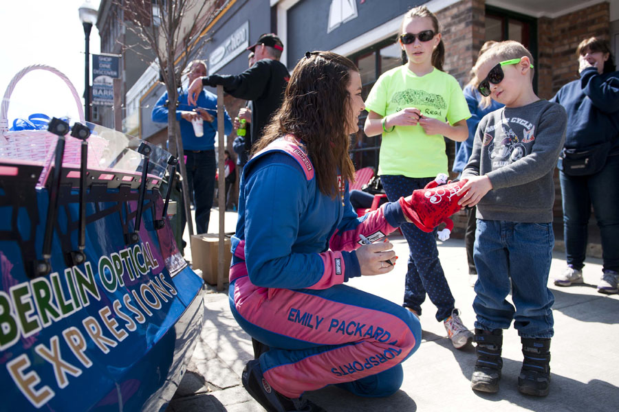 Emily Packard, center, signs autographs for Tiler Emerson, 7 of Williamstown, at right, and Avery Murphy, 11 of Fayston, in back, at the Thunder Road Car Show on Main Street in Barre, Vermont on Saturday, April 27, 2013.