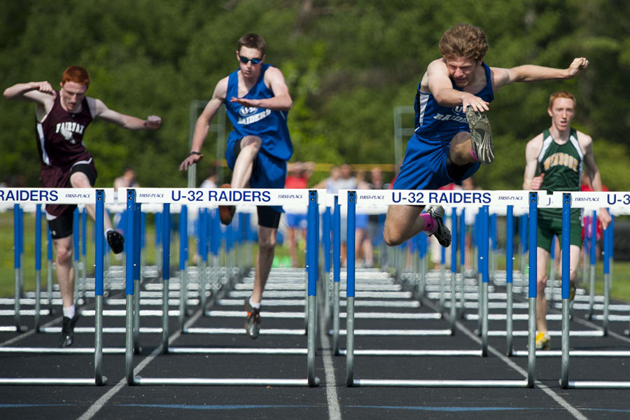 U-32 Ben Merrylees clears the final hurdle ahead of, from left to right, Bfa-Fairfax Connor Allen, U-32 David Koonz, and Windsor High School's Roger Barraby in the boys 110m Hurdles at U-32 High School in East Montpelier Vermont on Wednesday, May 21, 2013.