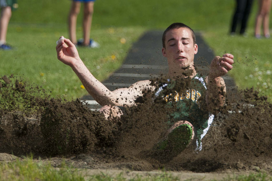 "Windsor High School senior Leo Patenaude lands a long jump attempt at U-32 High School in East Montpelier Vermont on Wednesday, May 21, 2013. His best jump for the day measured 18' 1""."