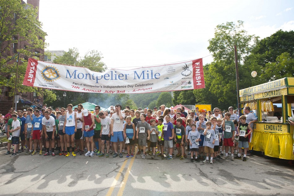Photo by Adam Caira Runners line up for the start of the Montpelier Mile road race on State St. in Montpelier Vt., on Wednesday, July 3, 2013., part of Montpelier's Independence Day Celebration.