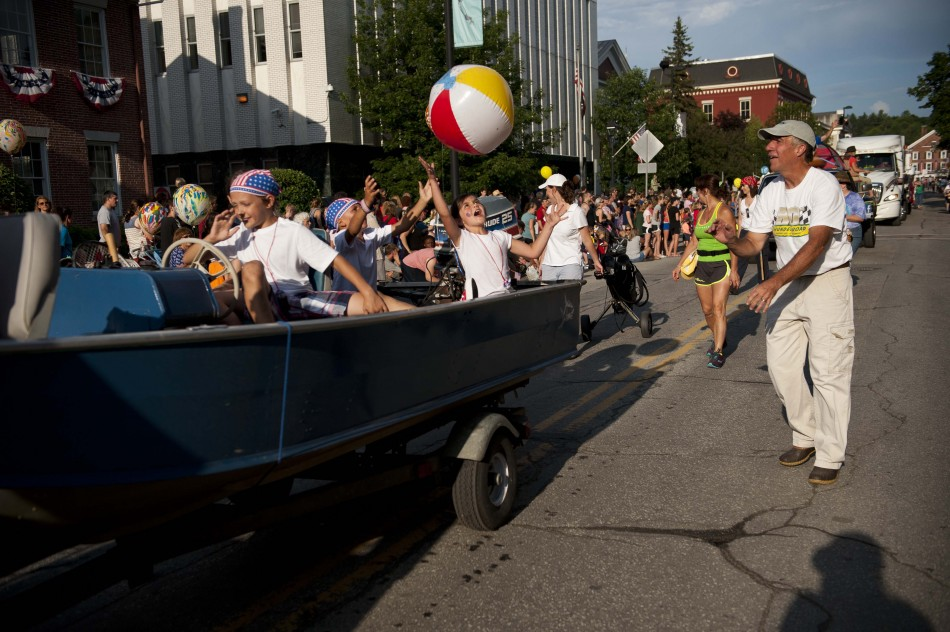 Photo by Adam Caira The Vacation Vermont float tosses beach balls back and forth with the crowd as they make their way down State St. in Montpelier Vt., on Wednesday, July 3, 2013., part of Montpelier's Independence Day Celebration.