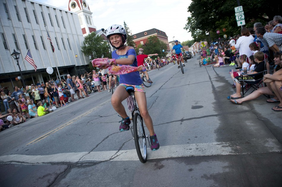 Photo by Adam Caira A group of unicyclists make their way down State St. in Montpelier Vt., on Wednesday, July 3, 2013., part of Montpelier's Independence Day Celebration.