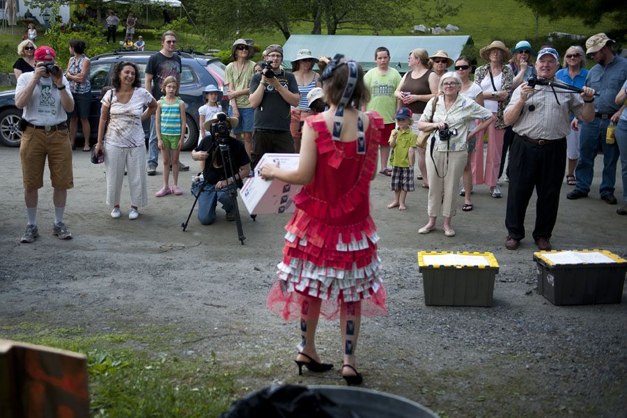 Photo by Adam Caira Erika Mitchell, wearing an outfit of materials from the US Postal Service via Adamant's Mailman Doug Nickleson, shows off in front of the gathered crowd during the fashion show at Adamant's 11th Annual Blackfly Festival in Adamant, Vt. on Saturday, June 1, 2013.