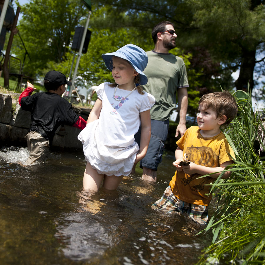 Photo by Adam Caira l-r Finley Martin, 6, and her brother Teagan Martin, 3, along with their father Trey Martin, background, cool off in the brook at Adamant's 11th Annual Blackfly Festival in Adamant, Vt. on Saturday, June 1, 2013.