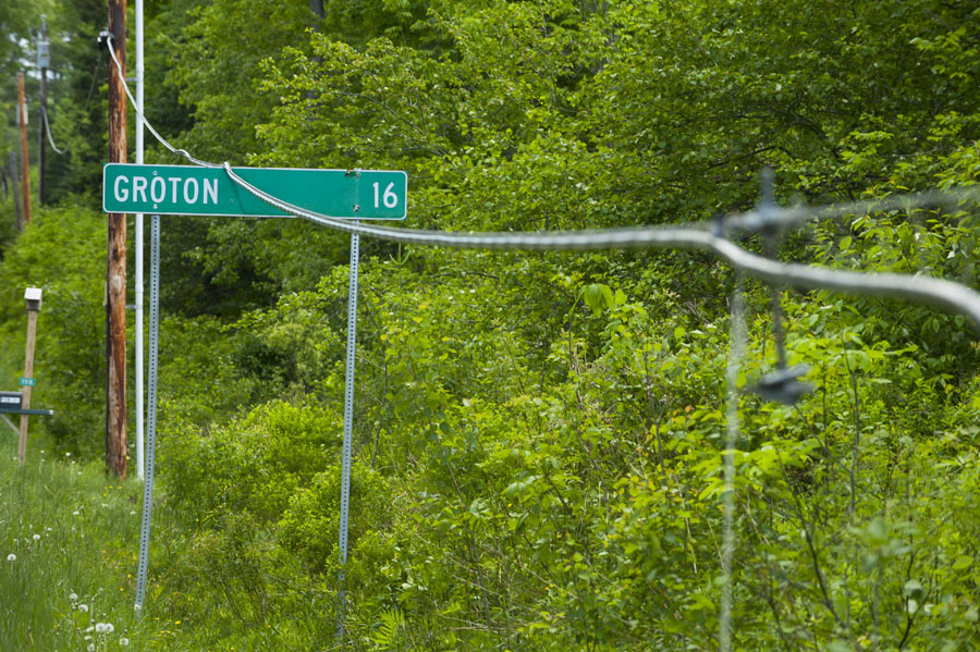 Photo by Adam Caira A line is down resting on the sign for Groton on Rout 232 (New Discovery Rd) headed out of Marshfield, Vt. on Monday, June 3, 2013.