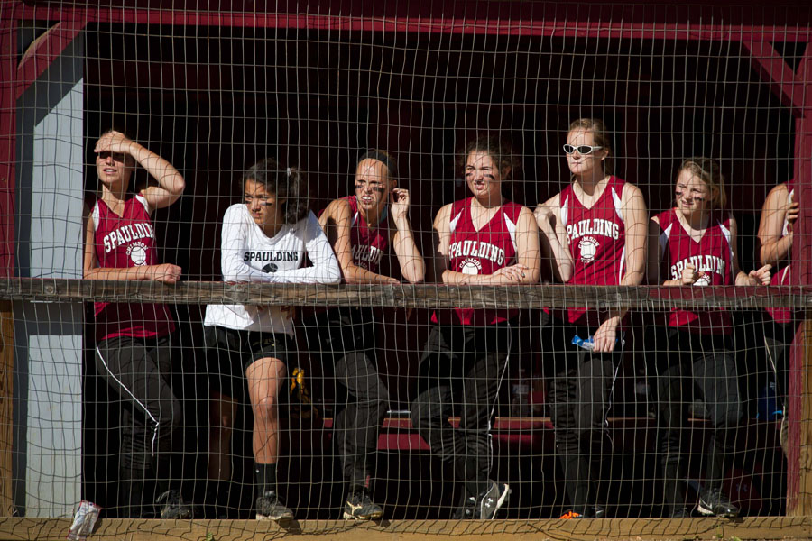 Photo by Adam Caira Spaulding softball players watch from the dugout as one of their teammates bats in in the third inning of their game against St. Johnsbury Academy in Barre, Vt. on Tuesday, June 4, 2013.