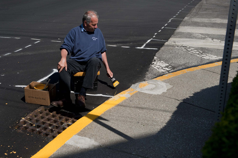 Photo By Adam Caira Mike Carbonneau, a licenced funeral director at Pruneau-Polli Funeral Home re-paints the yellow curb in front of the Funeral Home at the corner of Summer Street and West Street in Barre, Vt. on Tuesday, June 4, 2013. Carbonneau says that when he isn't busy conducting funerals he often spends his time performing maintanance and keeping the property looking clean and sharp. He hopes that any small contributions that he and the funeral home can make will help to keep downtown Barre looking its best.