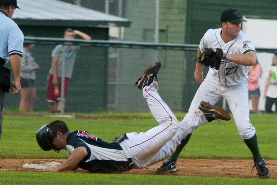 Photo by Adam Caira Vermont Mountaineers pitcher #27 Trey Oest tags Holyoke Blue Sox's Spencer Brann out at third after a run-down in the 4th inning at Recreation Field in Montpelier, Vermont, on Wednesday, June 26, 2013.