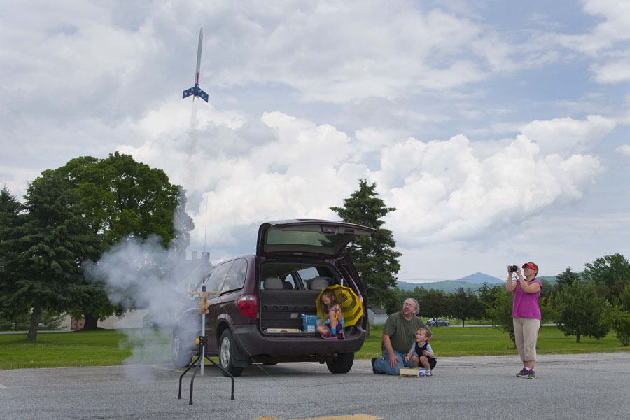 Photo by Adam Caira Brandy Perez, far right, and her husband, Greg Perez, center, launch a model rocket with their children, Sophia Perez, 7, left, and Jason Perez, 4, center, at the Barre Town Recreation Fields in Barre, Vermont, on Thursday, June 27, 2013.