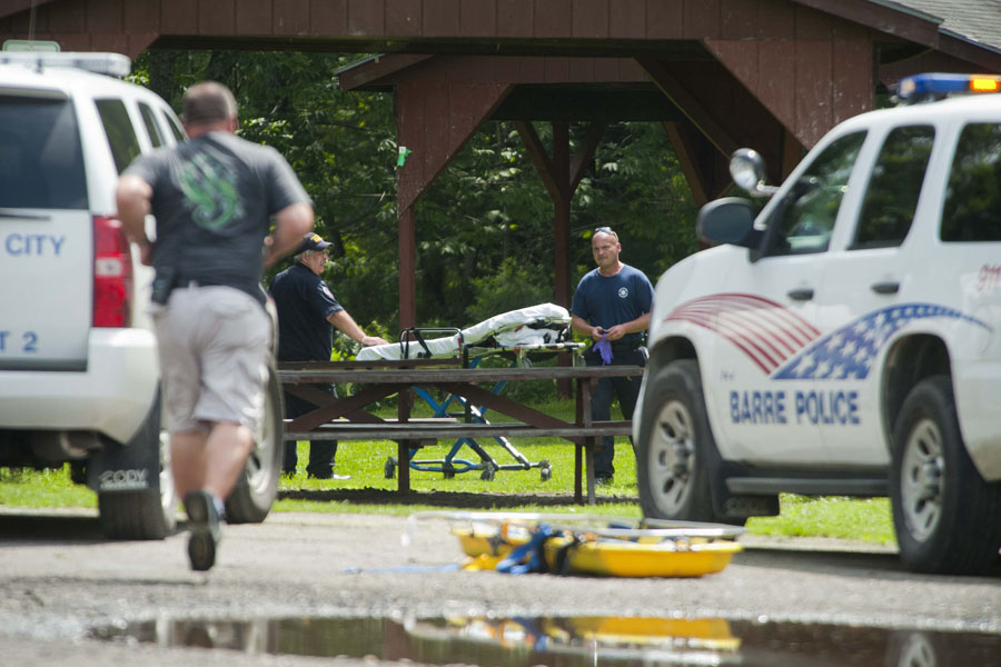 Photo by Adam Ciara Rescuers prepare a gurney on Parkside Terrace in Barre in preparation for the second of two victims. Rescue crews removed two men from the Jail Branch just below Spaulding falls in Barre Vt. on Tuesday, July 2, 2013. Crews accessed the scene by cutting a path from Parkside Terrace near the Barre City Pool.