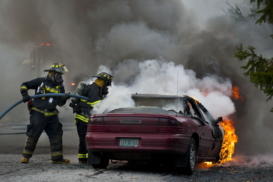Berlin Firefighters work to extinguish a fire that engulfed a Dodge Intrepid on Hersey Rd. in Berlin Vermont on Monday, Oct. 22, 2012, around 3:30pm. Nick Diedrich of Plainfield owns the car and was driving the car and had just left home when the fire broke out. He said he
